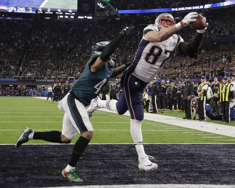 FILE - In this Feb. 4, 2018, file photo, New England Patriots' Rob Gronkowski (87) makes a touchdown reception against Philadelphia Eagles cornerback Ronald Darby during the second half of the NFL Super Bowl 52 football game in Minneapolis. (AP Photo/Chris O'Meara. File)