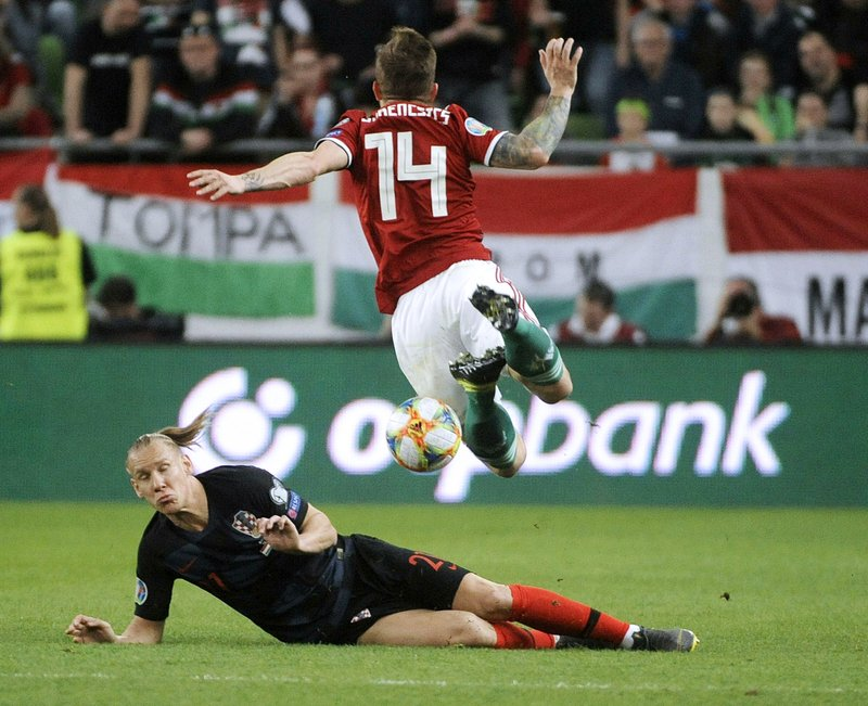 Gergo Lovrencsics, right, of Hungary and Domagoj Vida of Croatia in action during the UEFA EURO 2020 qualifying soccer match between Hungary and Croatia in Groupama Arena in Budapest, Hungary, Sunday, March 24, 2019. (Balazs Czagany/MTI via AP)