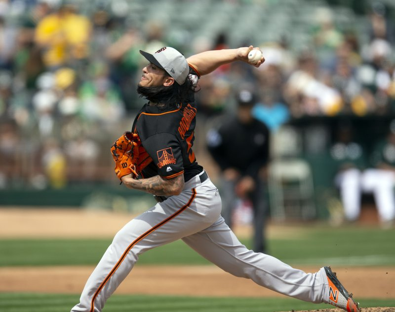 San Francisco Giants starting pitcher Dereck Rodriguez delivers against the Oakland Athletics during the third inning of an exhibition baseball game Sunday, March 24, 2019, in Oakland, Calif. (AP Photo/D. Ross Cameron)