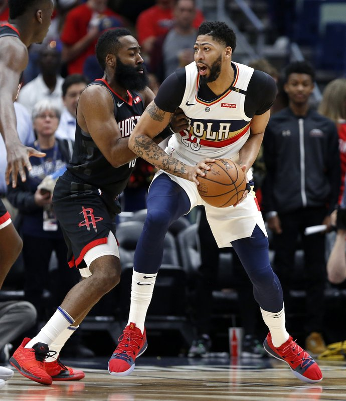 New Orleans Pelicans forward Anthony Davis (23) is defended by Houston Rockets guard James Harden, left, during the first half of an NBA basketball game in New Orleans, Sunday, March 24, 2019. (AP Photo/Tyler Kaufman)