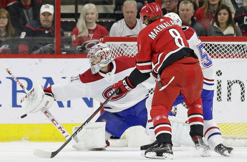 Montreal Canadiens goalie Carey Price (31) blocks Carolina Hurricanes' Saku Maenalanen (8), of Finland, during the first period of an NHL hockey game in Raleigh, N. (AP Photo/Gerry Broome)