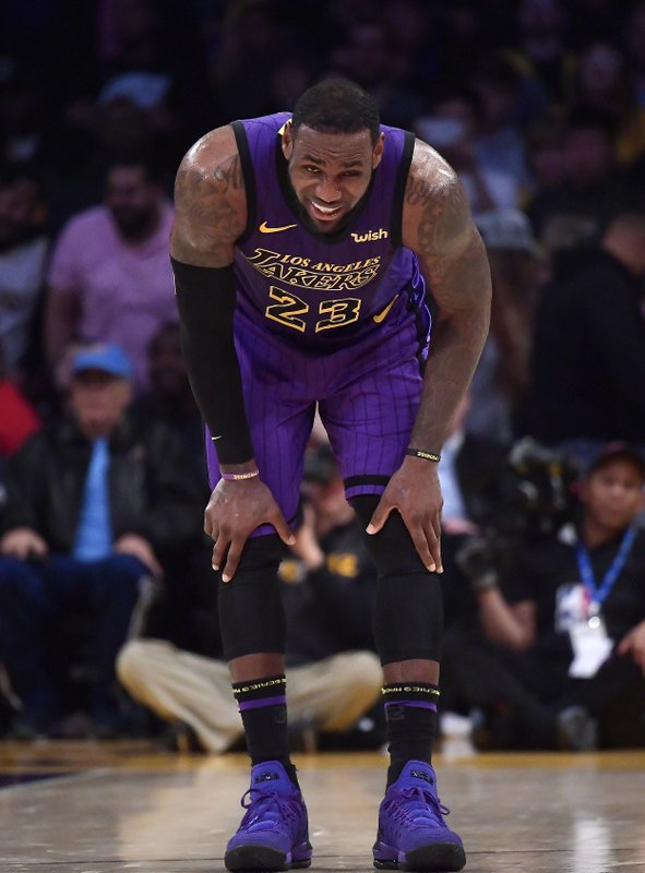 Los Angeles Lakers forward LeBron James winces after falling during the second half of an NBA basketball game against the Brooklyn Nets Friday, March 22, 2019, in Los Angeles. (AP Photo/Mark J. Terrill)
