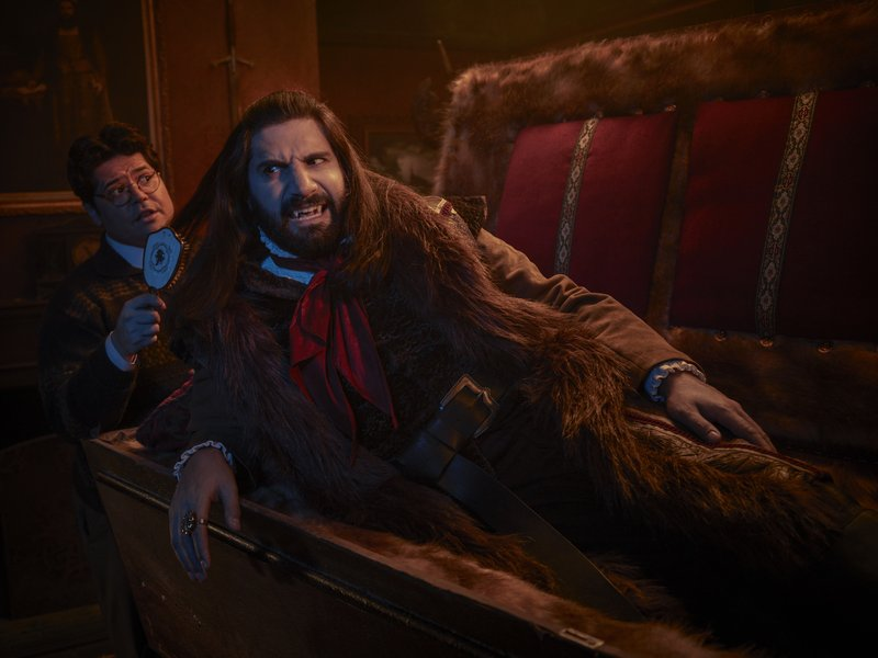 This image released by FX shows Kayvan Novak and Harvey Guillen, left, in a scene from