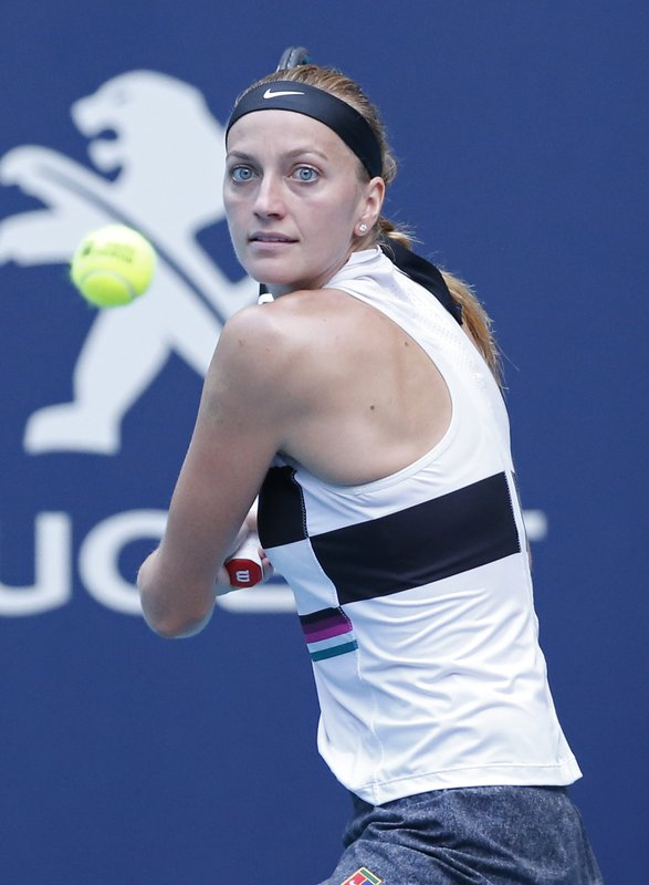 Petra Kvitova, of the Czech Republic, returns a volley to Caroline Garcia, of France, during the Miami Open tennis tournament, Monday, March 25, 2019, in Miami Gardens, Fla. (AP Photo/Joel Auerbach)