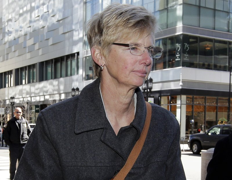 Donna Heinel, former USC athletics administrator, arrives at federal court in Boston on Monday, March 25, 2019, to face charges in a nationwide college admissions bribery scandal. (AP Photo/Steven Senne)