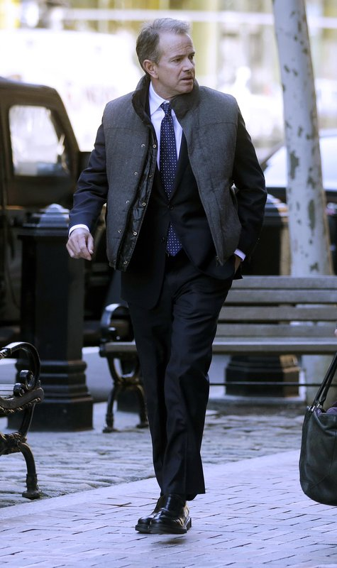 Gordon Ernst, former Georgetown tennis coach, arrives at federal court in Boston on Monday, March 25, 2019, to face charges in a nationwide college admissions bribery scandal. (AP Photo/Steven Senne)