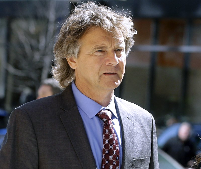 Jovan Vavic, former University of Southern California water polo coach, arrives at federal court in Boston on Monday, March 25, 2019, to face charges in a nationwide college admissions bribery scandal. (AP Photo/Steven Senne)