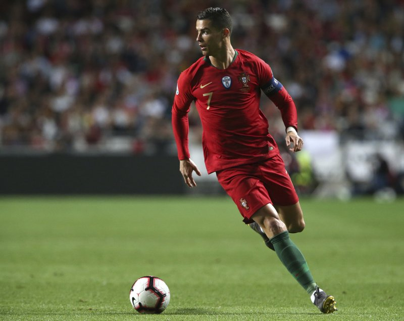 Portugal's Cristiano Ronaldo controls the ball during the Euro 2020 group B qualifying soccer match between Portugal and Serbia at the Luz stadium in Lisbon, Portugal, Monday, March 25, 2019. (AP Photo/Armando Franca)