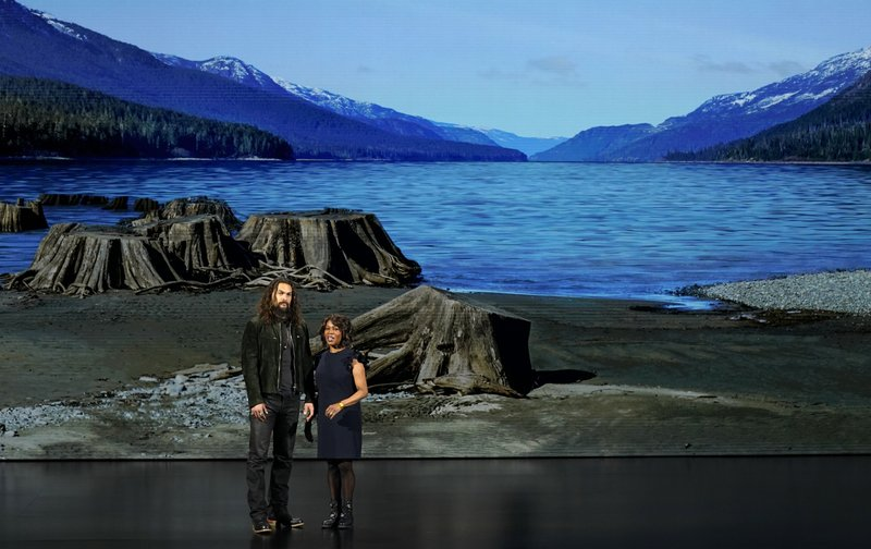Jason Momoa, left, and Alfre Woodard speak at the Steve Jobs Theater during an event to announce Apple new products Monday, March 25, 2019, in Cupertino, Calif. (AP Photo/Tony Avelar)