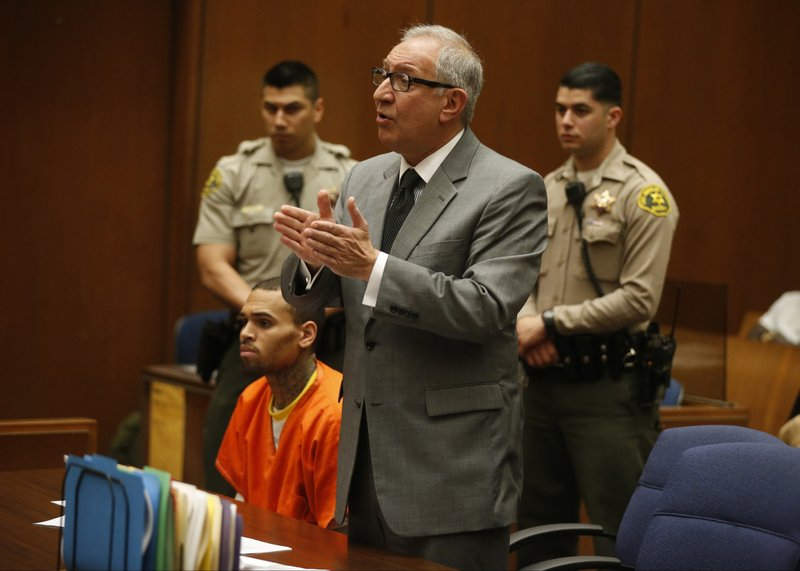 File - In this March 17, 2014, file photo, R&B singer Chris Brown, left, appears in Los Angeles Superior Court with his attorney Mark Geragos. (AP Photo/Lucy Nicholson, Pool)
