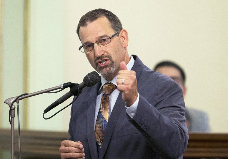 FILE - This Aug. 23, 2016 photo shows Assemblyman Brian Dahle, R-Bieber, speaking at the Capitol in Sacramento, Calif. (AP Photo/Rich Pedroncelli, File)