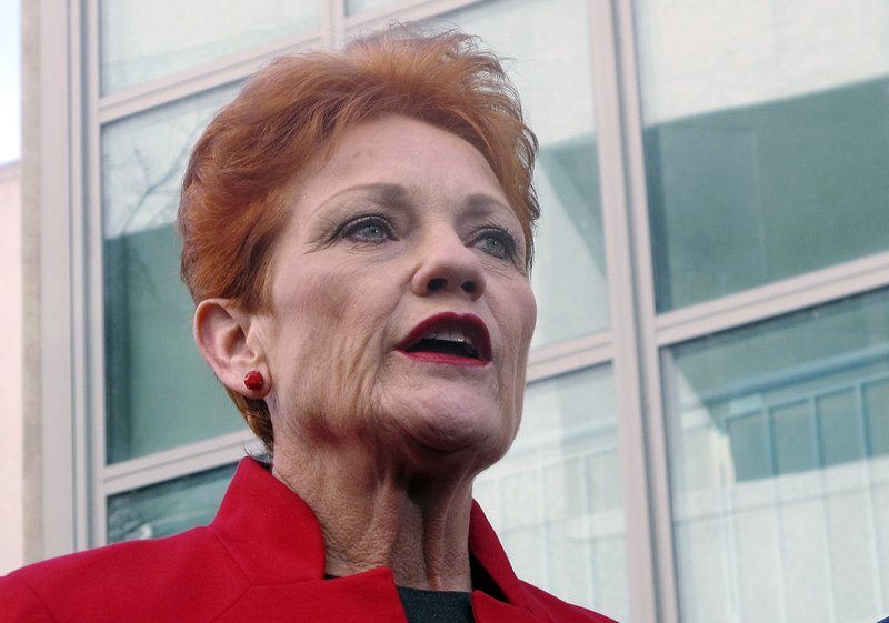 In this June 21, 2018, file photo One Nation party senator Pauline Hanson addresses the media at Parliament House in Canberra, Australia. (AP Photo/Rod McGuirk, File)