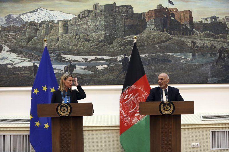 Afghan President Ashraf Ghani, right, speaks during a press conference with European Union foreign policy chief Federica Mogherini at the presidential palace in Kabul, Afghanistan, Tuesday, March 26, 2019. (AP Photo/Rahmat Gul)