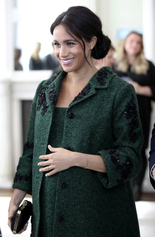 FILE - In this March 11, 2019 file photo, Britain's Meghan, Duchess of Sussex arrive for the Commonwealth Day Youth Event with Prince Harry, at Canada House in London. (Chris Jackson/Pool Photo via AP, File)