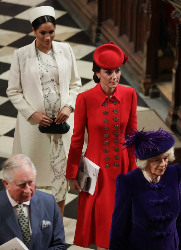 FILE - In this March 11, 2019 file photo, Britain's Kate, Duchess of Cambridge and Meghan, Duchess of Sussex leave after attending the Commonwealth Service at Westminster Abbey in London. (AP Photo/Kirsty Wigglesworth, Pool)
