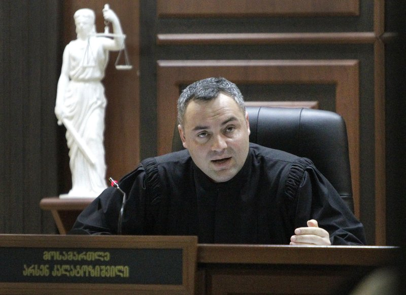 Judge Arsen Kalatozishvili attends a court session, in Tbilisi, Georgia, Tuesday, March 26, 2019. A court in Georgia has ruled to extradite a fugitive British man wanted for manslaughter in the case of a woman who was killed during a London date on a speedboat. (AP Photo/Shakh Aivazov)