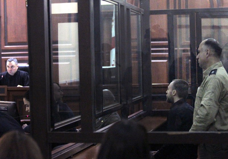 Briton Jack Shepherd sits in a court room in Tbilisi, Georgia, Tuesday, March 26, 2019. A court in Georgia has ruled to extradite a fugitive British man wanted for manslaughter in the case of a woman who was killed during a London date on a speedboat. (AP Photo/Shakh Aivazov)