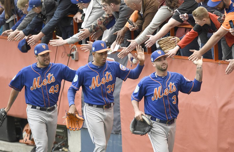 New York Mets baseball players, from left, Luis Avilan (43), Edwin Diaz (39) and Tomas Nido (3)  greet fans after a workout at the Carrier Dome in Syracuse, N. (Dennis Nett/The Post-Standard via AP)