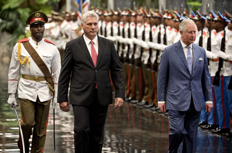 Britain's Prince Charles, the Prince of Wales, right, and Cuba's President Miguel Diaz-Canel review an honor guard at the Revolution Palace during his official visit to Cuba, in Havana, Cuba, Monday, March 25, 2019. (AP Photo/Ramon Espinosa)