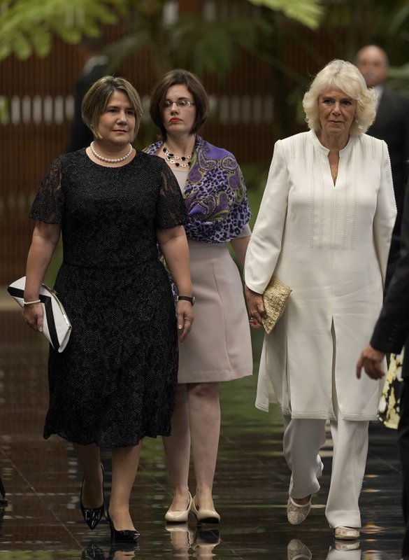 Lis Cuesta, left, wife of Cuba's President Miguel Diaz Canel and Camilla, Duchess of Cornwall, right, arrives ahead of Britain's Prince Charles, the Prince of Wales, and Cuba's President Miguel Diaz-Canel, are to review an honor guard at Revolution Palace during the Prince of Wales' official visit, in Havana, Cuba, Monday, March 25, 2019. (AP Photo/Ramon Espinosa)