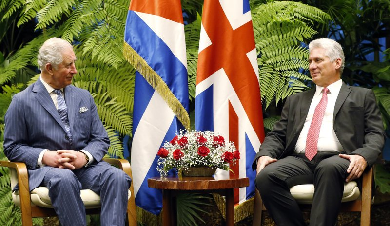 Britain's Prince Charles, the Prince of Wales, left, and Cuba's President Miguel Diaz-Canel, smile at each other during a meeting at Revolution Palace, in Havana, Cuba, Monday, March 25, 2019 (Ernesto Mastrascusa/Pool via AP)
