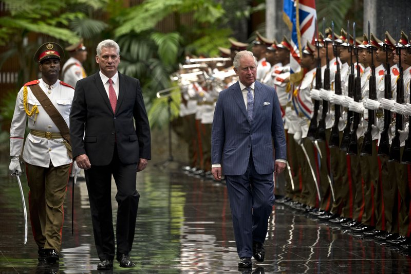 Britain's Prince Charles, the Prince of Wales, right, and Cuba's President Miguel Diaz-Canel review an honor guard at Revolution Palace during his official visit to Cuba, in Havana, Cuba, Monday, March 25, 2019. (AP Photo/Ramon Espinosa)