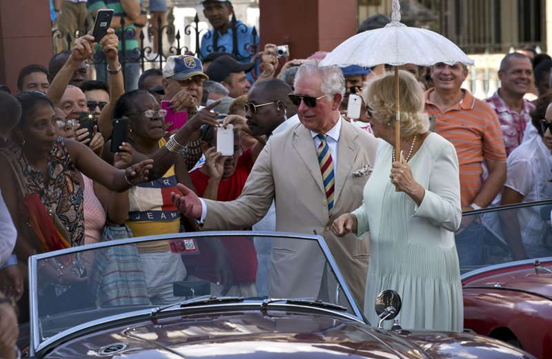 Prince Charles and his wife Camilla, Duchess of Cornwall, greet onlookers during a cultural event in Havana, Cuba, Tuesday, March 26, 2019. (AP Photo/Ramon Espinosa)