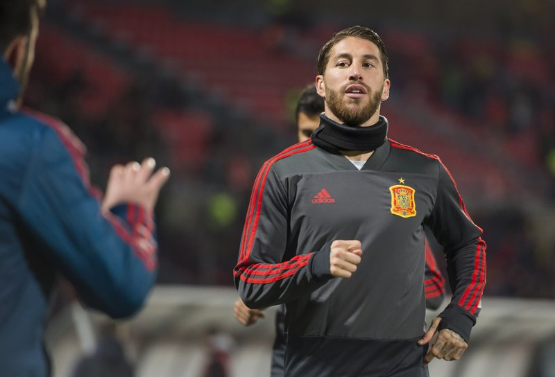 Spain team captain Sergio Ramos warms up before the Euro 2020 group F qualifying soccer match between Malta and Spain at the national stadium Ta Qali Malta, Tuesday, March 26, 2019. (AP Photo/Rene Rossignaud)