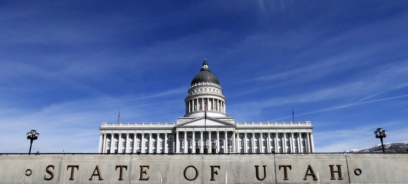 FILE - In this March 8, 2018, file photo, shows the Utah State Capitol in Salt Lake City. Utah Gov. Gary Herbert has signed a law banning most abortions after 18 weeks of gestation, setting the stage for a legal showdown. (AP Photo/Rick Bowmer, File)