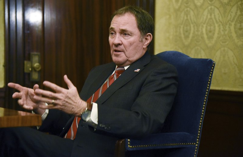 FILE - In this March 14, 2019, file photo, Utah Gov. Gary Herbert speaks during an interview on the final day of the legislative session at the Utah State Capitol in Satl Lake City. (Francisco Kjholseth/The Salt Lake Tribune via AP, File)