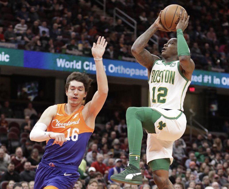 Boston Celtics' Terry Rozier (12) drives to the basket against Cleveland Cavaliers' Cedi Osman (16) in the first half of an NBA basketball game, Tuesday, March 26, 2019, in Cleveland. (AP Photo/Tony Dejak)