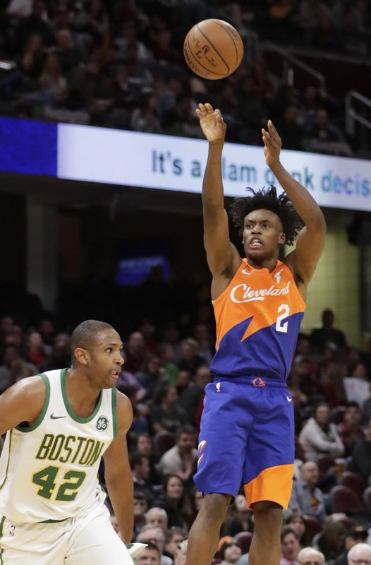 Cleveland Cavaliers' Collin Sexton (2) shoots over Boston Celtics' Al Horford (42) in the second half of an NBA basketball game, Tuesday, March 26, 2019, in Cleveland. (AP Photo/Tony Dejak)