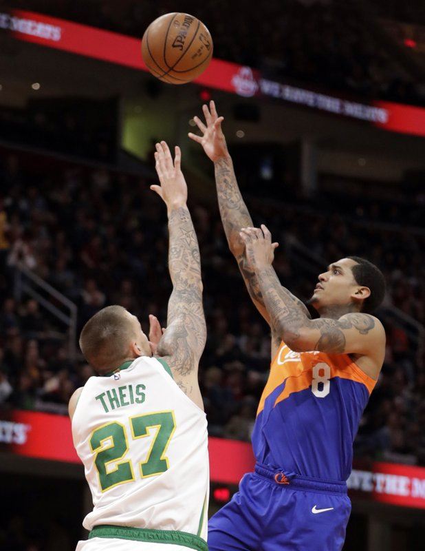 Cleveland Cavaliers' Jordan Clarkson (8) shoots over Boston Celtics' Daniel Theis (27) in the second half of an NBA basketball game, Tuesday, March 26, 2019, in Cleveland. (AP Photo/Tony Dejak)