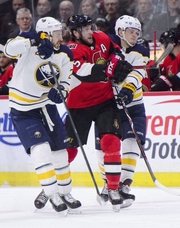 Ottawa Senators right wing Bobby Ryan (9) gets squeezed between Buffalo Sabres centre Zemgus Girgensons (28), left, and Buffalo Sabres centre Casey Mittelstadt (37) during first period NHL hockey action in Ottawa, Ontario, on Tuesday, March 26, 2019. (Sean Kilpatrick/The Canadian Press via AP)