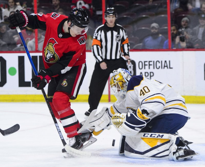 Ottawa Senators left wing Brady Tkachuk (7) tries to tip the puck past Buffalo Sabres goaltender Carter Hutton (40) during first period NHL hockey action in Ottawa, Ontario, on Tuesday, March 26, 2019. (Sean Kilpatrick/The Canadian Press via AP)