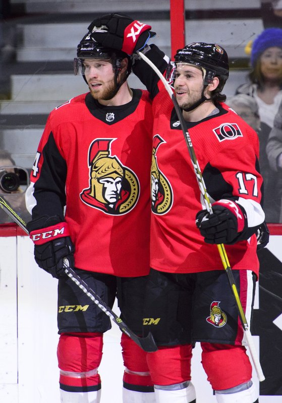Ottawa Senators left wing Brian Gibbons (17) celebrates a first period goal with teammate Ottawa Senators Oscar Lindberg (24) during first period NHL hockey action against the Buffalo Sabres in Ottawa, Ontario, on Tuesday, March 26, 2019. (Sean Kilpatrick/The Canadian Press via AP)