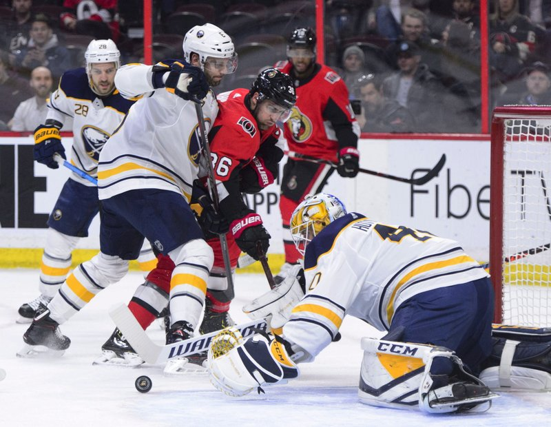 Buffalo Sabres goaltender Carter Hutton (40) moves to cover the puck during first period NHL hockey action against the Ottawa Senators in Ottawa, Ontario, on Tuesday, March 26, 2019. (Sean Kilpatrick/The Canadian Press via AP)