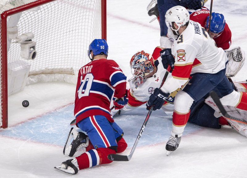 Montreal Canadiens left wing Tomas Tatar (90) scores his second goal of the game against Florida Panthers goaltender James Reimer (34) during the first period of an NHL hockey game Tuesday, March 26, 2019, in Montreal. (Ryan Remiorz/The Canadian Press via AP)