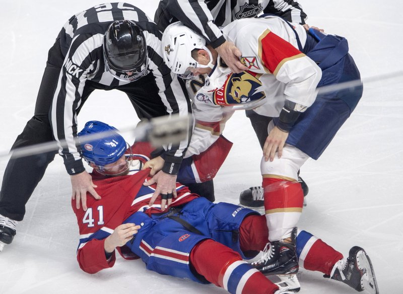 Florida Panthers defenseman MacKenzie Weegar (52) knocks out Montreal Canadiens left wing Paul Byron (41) during the first period of an NHL hockey game Tuesday, March 26, 2019, in Montreal. (Ryan Remiorz/The Canadian Press via AP)