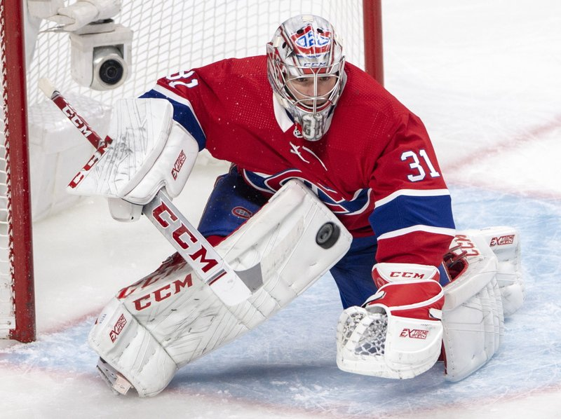Montreal Canadiens goaltender Carey Price (31) keeps his eye on a loose puck during the second period of an NHL hockey game against the Florida Panthers, Tuesday, March 26, 2019, in Montreal. (Ryan Remiorz/The Canadian Press via AP)