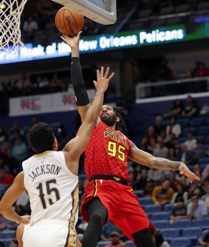 Atlanta Hawks forward DeAndre' Bembry (95) shoots against New Orleans Pelicans guard Frank Jackson (15) in the first half of an NBA basketball game in New Orleans, Tuesday, March 26, 2019. (AP Photo/Gerald Herbert)