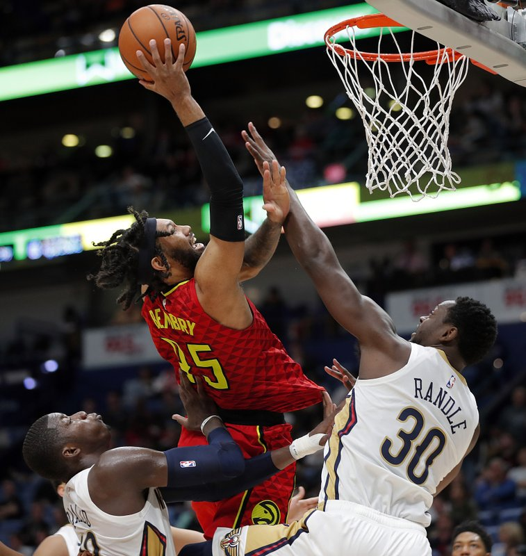 Atlanta Hawks forward DeAndre' Bembry (95) shoots against New Orleans Pelicans center Julius Randle (30) in the first half of an NBA basketball game in New Orleans, Tuesday, March 26, 2019. (AP Photo/Gerald Herbert)