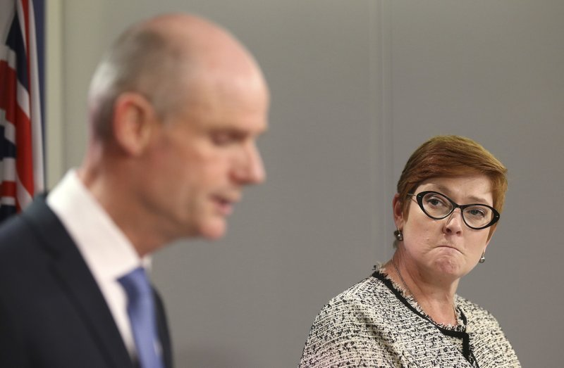 Australian Minister for Foreign Affairs, Marise Payne, right, listens as Netherlands' Minister of Foreign Affairs, Stef Blok, talks during a press conference in Sydney, Australia, Wednesday, March 27, 2019. (AP Photo/Rick Rycroft)