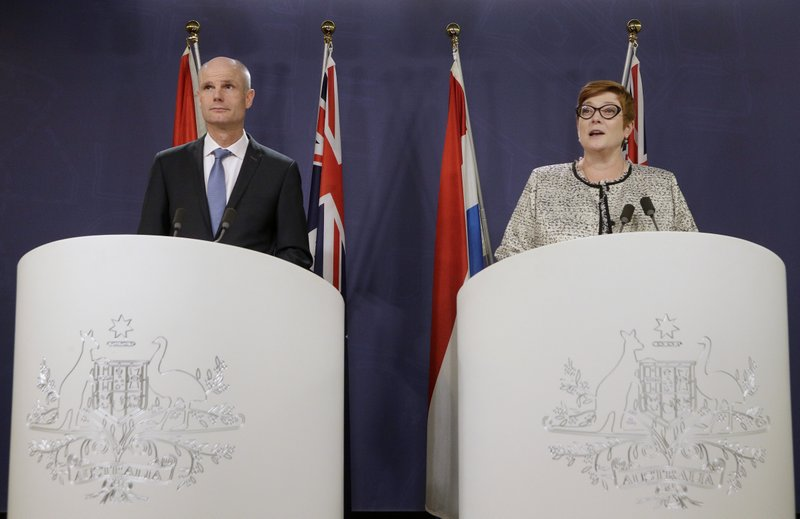 Netherlands' Minister of Foreign Affairs, Stef Blok, left, and Australian Minister for Foreign Affairs, Marise Payne hold a press conference in Sydney, Australia, Wednesday, March 27, 2019. (AP Photo/Rick Rycroft)