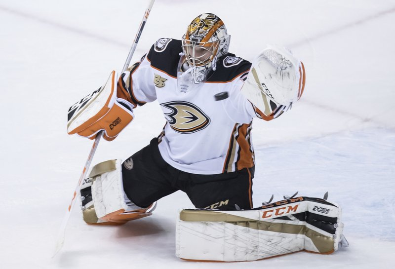 Anaheim Ducks goalie John Gibson makes a glove save during the second period of an NHL hockey game against the Vancouver Canucks in Vancouver, British Columbia, Tuesday, March 26, 2019. (Darryl Dyck/The Canadian Press via AP)