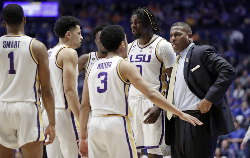 LSU interim head coach Tony Benford talks with his players in the second half of an NCAA college basketball game against Florida at the Southeastern Conference tournament Friday, March 15, 2019, in Nashville, Tenn. (AP Photo/Mark Humphrey)