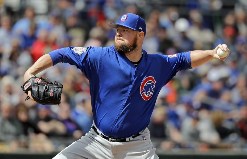 Chicago Cubs starting pitcher Jon Lester throws against the Oakland Athletics in the first inning of a spring training baseball game Wednesday, March 13, 2019, in Mesa, Ariz. (AP Photo/Elaine Thompson)