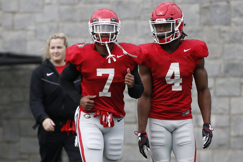 Georgia running back D'Andre Swift (7) and Georgia running back James Cook (4) at an NCAA football spring practice in Athens, Ga. (Joshua L. Jones/Athens Banner-Herald via AP)