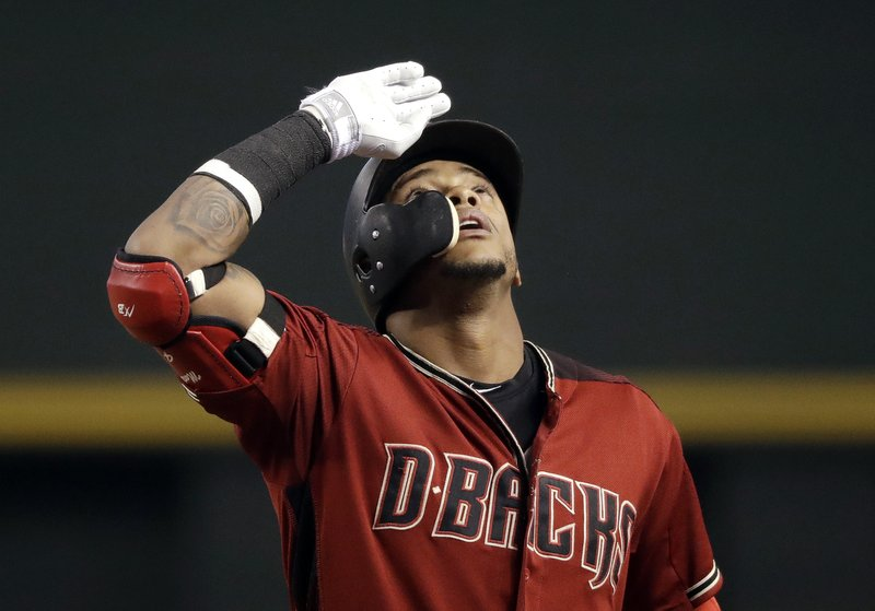 Arizona Diamondbacks' Ketel Marte looks skyward as he stands on first base after hitting a single against the Chicago White Sox in the second inning of a spring training baseball game Monday, March 25, 2019, in Phoenix, Ariz. (AP Photo/Elaine Thompson)