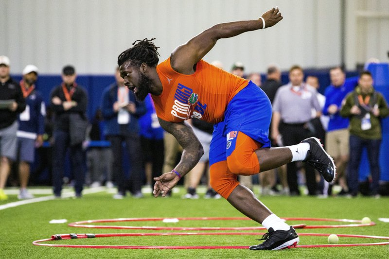 Defensive lineman Jachai Polite runs drills during the University of Florida's football Pro Day in Gainesville, Fla. (Lauren Bacho/The Gainesville Sun via AP)